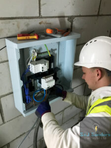 Joe installing a temporary board for 110v site transformers - S&J Sanders Electrical Ltd Local Electrician Yeovil